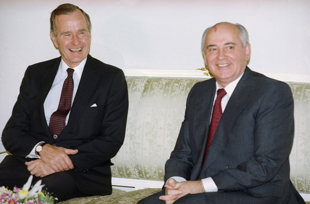 FILE - In this file photo taken on Tuesday, Oct. 29, 1991, U.S. President George H. Bush, left, and Soviet President Mikhail Gorbachev sit together at