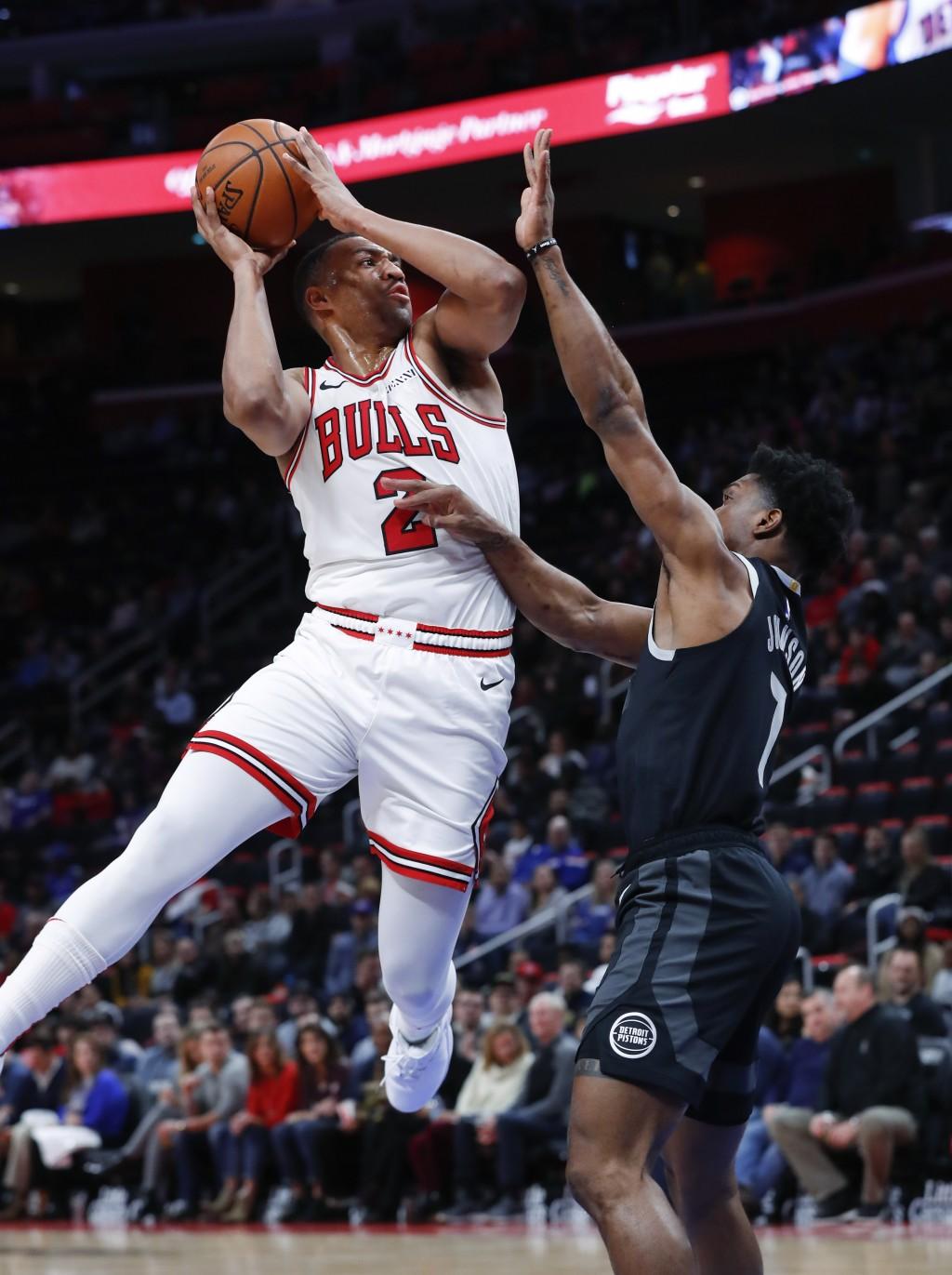 Chicago Bulls forward Jabari Parker (2) drives on Detroit Pistons forward Stanley Johnson (7) during the first half of an NBA basketball game in Detro