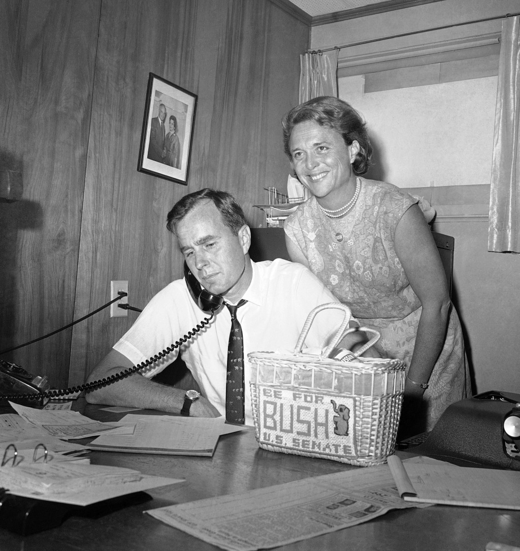 FILE - In this June 6, 1964, file photo George H.W. Bush, candidate for the Republican nomination for the U.S. Senate, gets returns by phone at his he...