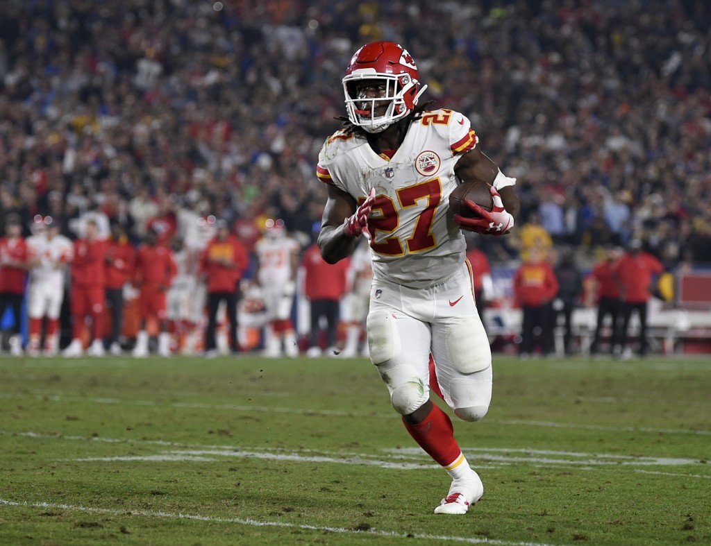 FILE - In this Nov. 19, 2018, file photo, Kansas City Chiefs running back Kareem Hunt carries during the second half of the team's NFL football game a...