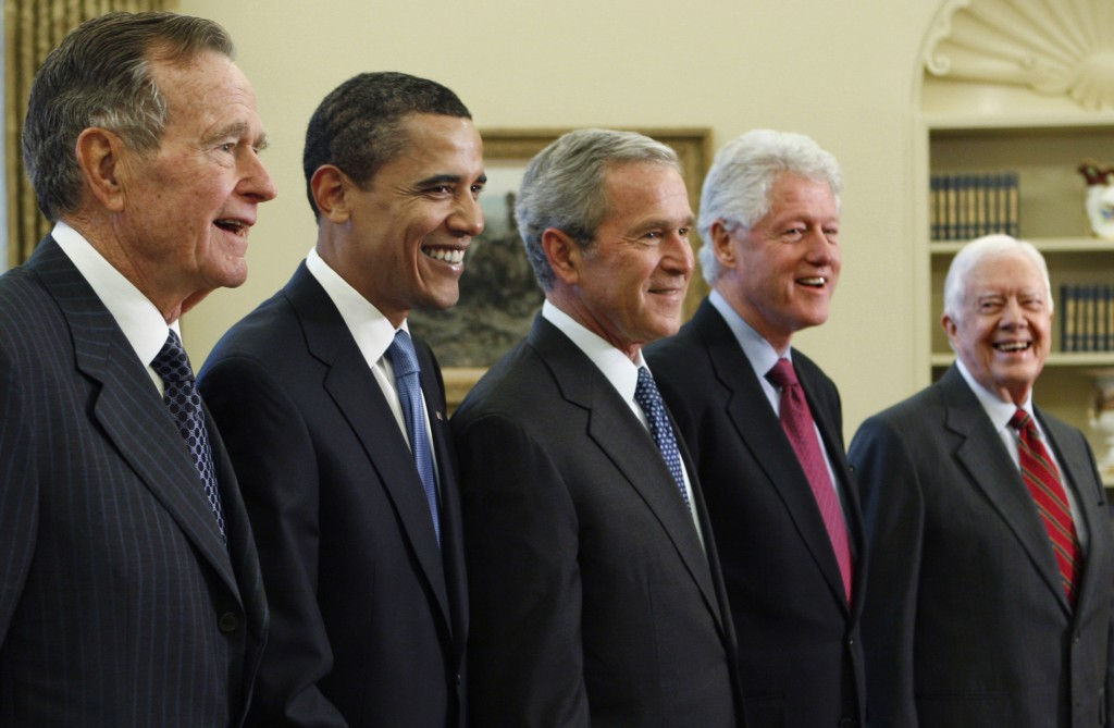 FILE - In this Jan. 7, 2009, file photo, President George W. Bush, center, poses with President-elect Barack Obama, second left, and former presidents