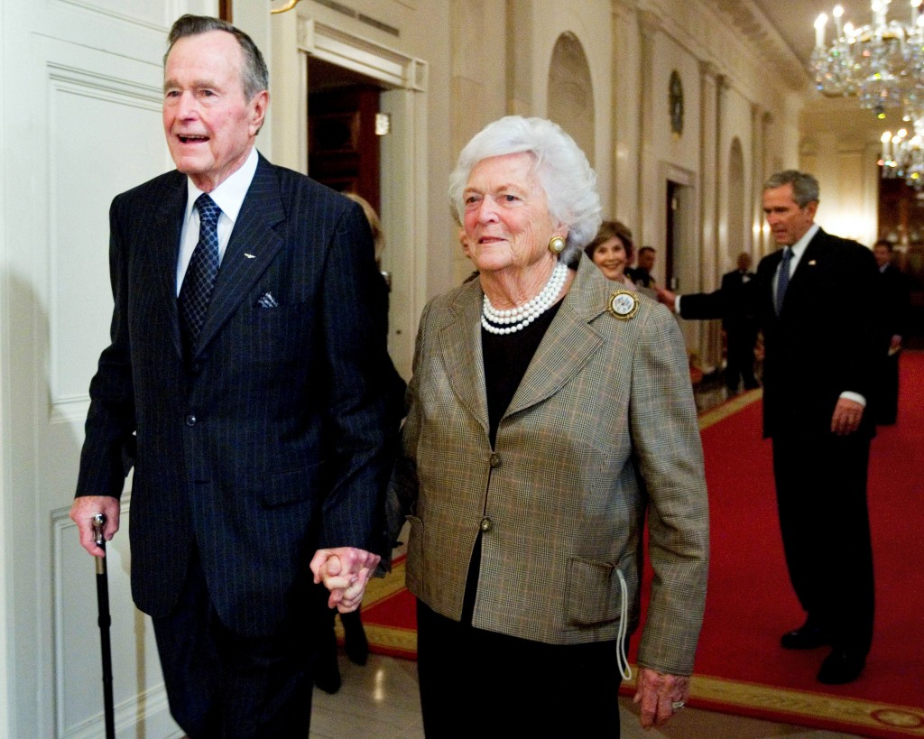 FILE - In this Jan. 7, 2009, file photo, former President George H.W. Bush, left, walks with his wife, Barbara Bush, followed by their son, President