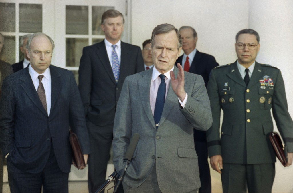 FILE - In this Feb. 11, 1991, file photo, President George H.W. Bush talks to reporters in the Rose Garden of the White House after meeting with top m...
