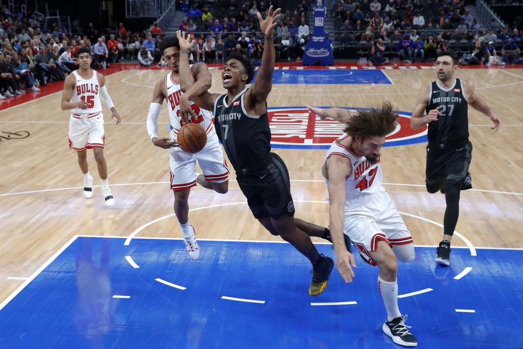 Chicago Bulls guard Cameron Payne (22) fouls Detroit Pistons forward Stanley Johnson (7) during the first half of an NBA basketball game in Detroit, F