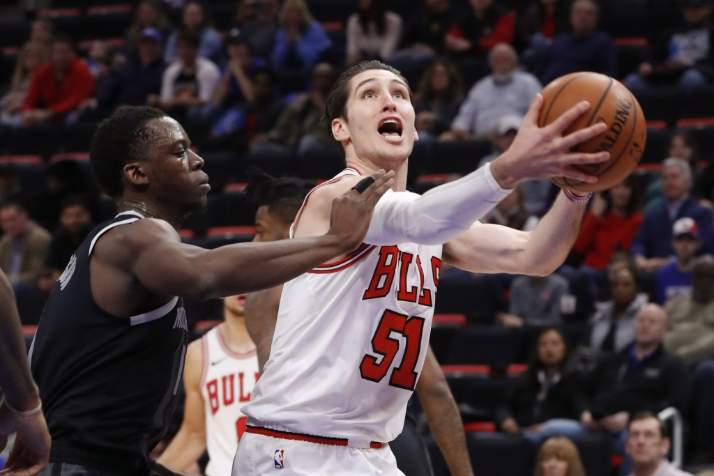 Chicago Bulls guard Ryan Arcidiacono (51) drives on Detroit Pistons guard Reggie Jackson, left, during the first half of an NBA basketball game in Det