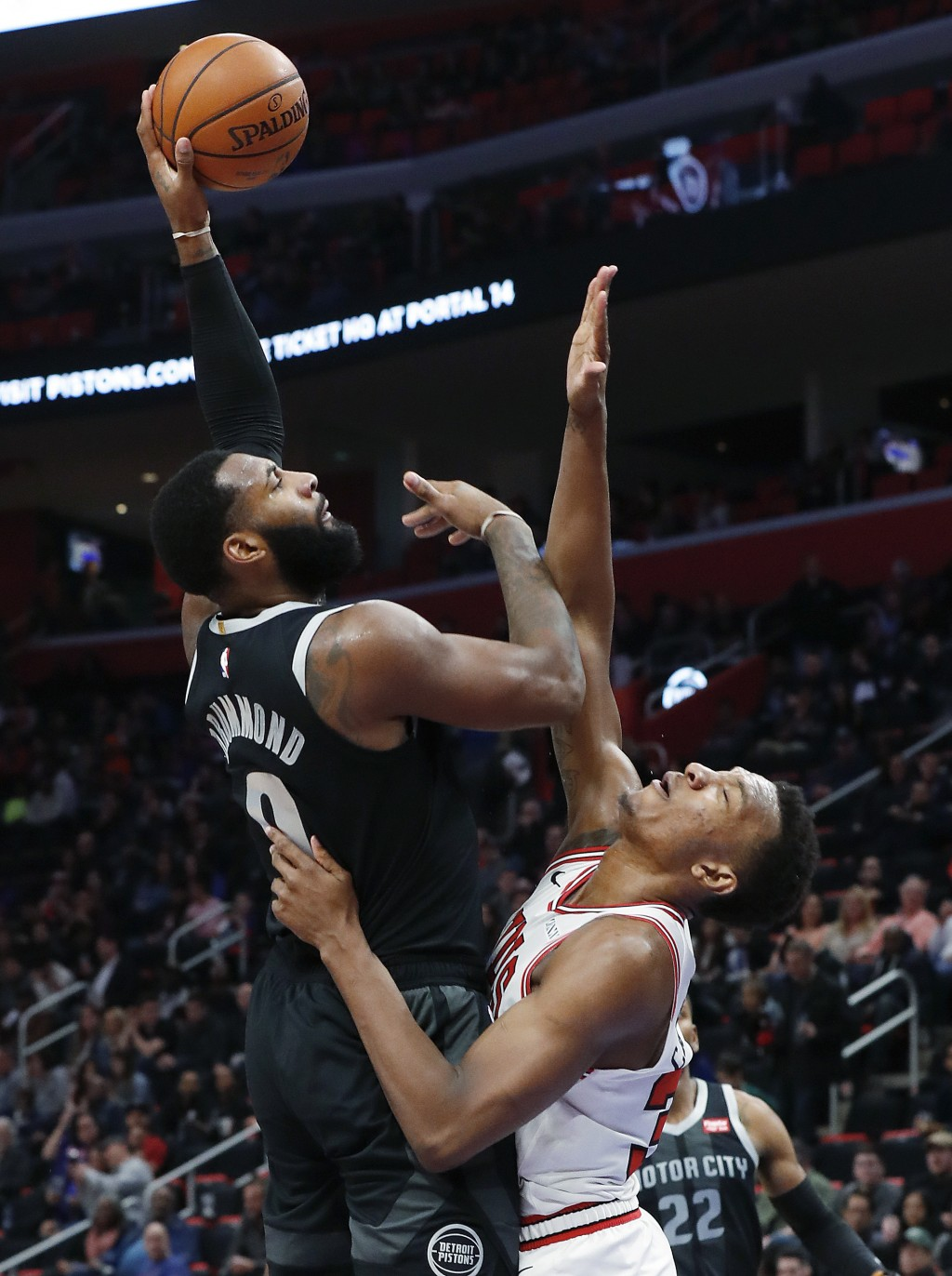 Detroit Pistons center Andre Drummond (0) shoots over Chicago Bulls forward Wendell Carter Jr. (34) during the second half of an NBA basketball game i