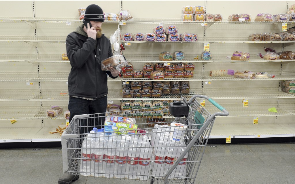 Anchorage resident C.J. Johnson stocks up on water and bread at a local grocery, after the morning's 7.0-magnitude earthquake which caused extensive d