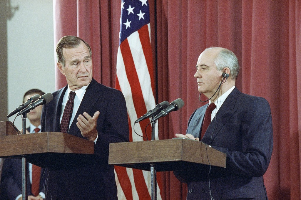 FILE - In this Oct. 29, 1991, file photo, President George H.W. Bush gestures during a joint news conference with Soviet President Mikhail Gorbachev,