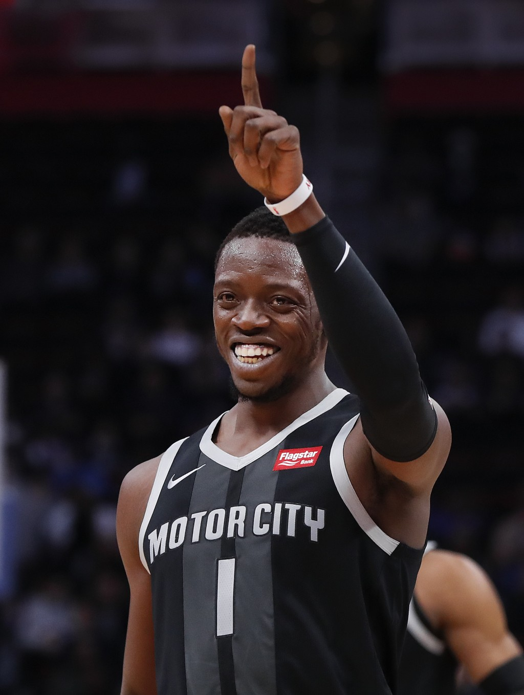 Detroit Pistons guard Reggie Jackson reacts to a basket during the first half of the team's NBA basketball game against the Chicago Bulls in Detroit,