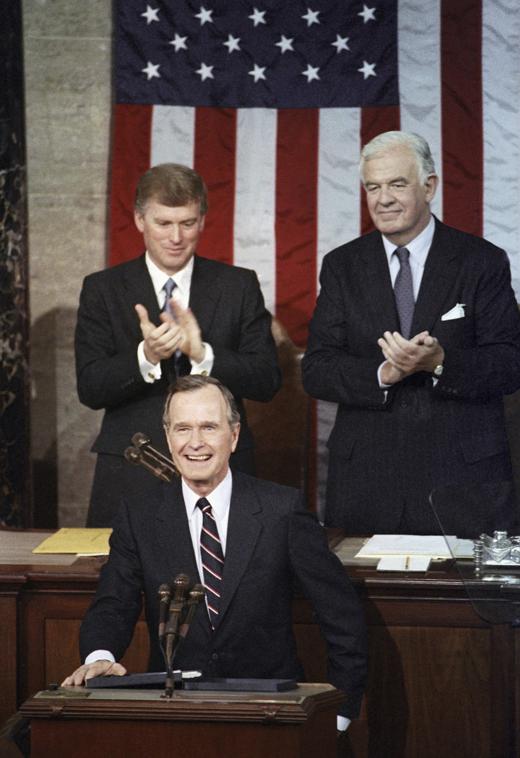 FILE - In this Jan. 31, 1990, file photo, President George H.W. Bush receives applause from Vice President Dan Quayle, left, and House Speaker Thomas