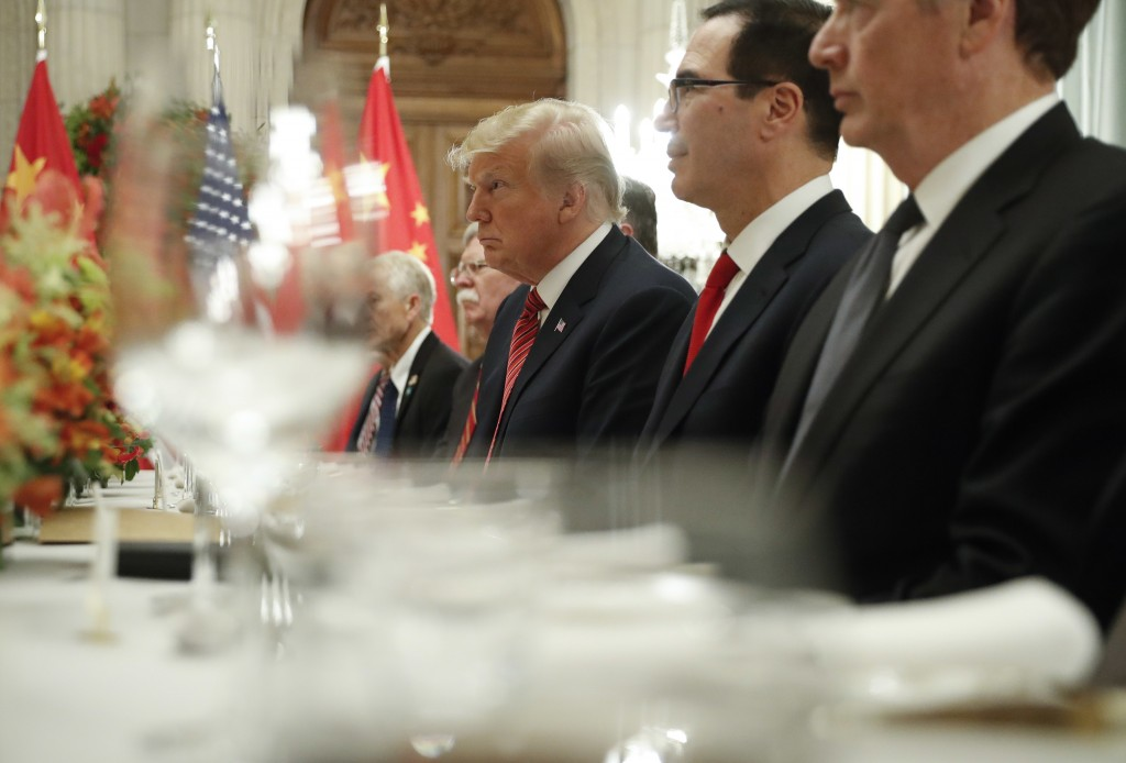 President Donald Trump, center, and Treasury Secretary Steve Mnuchin, second from the right, listen to remarks by China's President Xi Jinping during