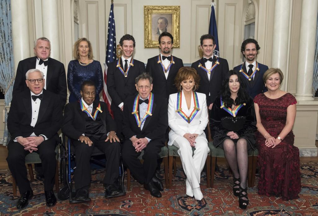 Front row from left, David Rubenstein, 2018 Kennedy Center Honorees Wayne Shorter, Philip Glass, Reba McEntire, Cher, Kennedy Center President Deborah...