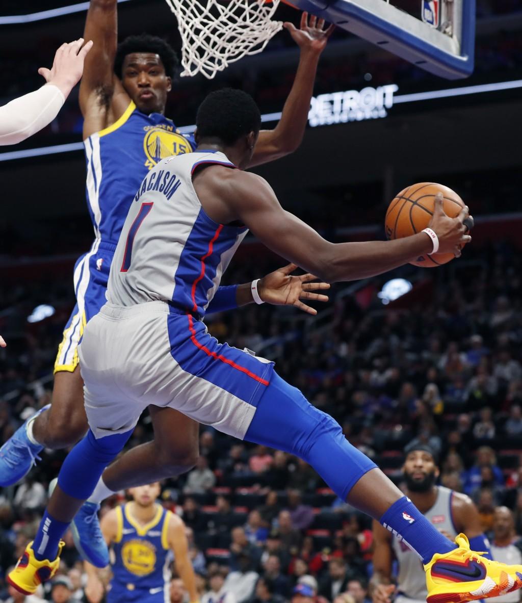 Detroit Pistons guard Reggie Jackson (1) pass ass Golden State Warriors center Damian Jones (15) defends during the first half of an NBA basketball ga