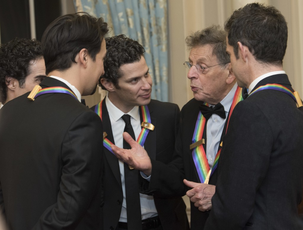 "2018 Kennedy Center Honoree Philip Glass, second right, talks with fellow Honorees, the co-creators of ""Hamilton,"" Thomas Kail, center, Lin-Manuel Mir"