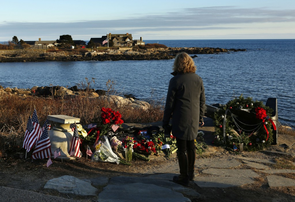 Cathy Rogers of Windham, Maine, pays her respects at a makeshift memorial for President George H. W. Bush across from Walker's Point, the Bush's summe