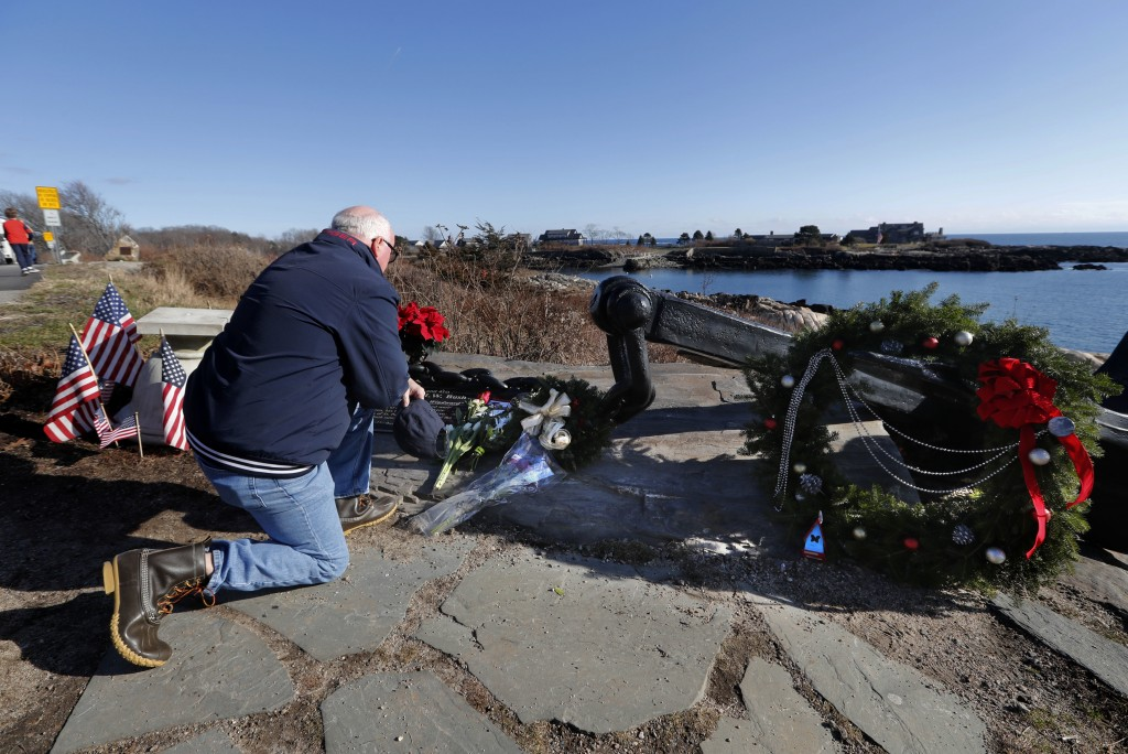 A man pays his respects to former President George H. W. Bush at a makeshift memorial across from Walker's Point, the Bush's summer home, Saturday, De...