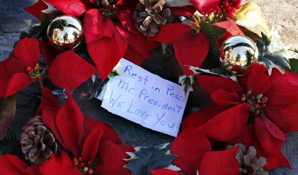 A wreath with a note to former President George H. W. Bush lay at a makeshift memorial across from Walker's Point, the Bush's summer home, Saturday, D...
