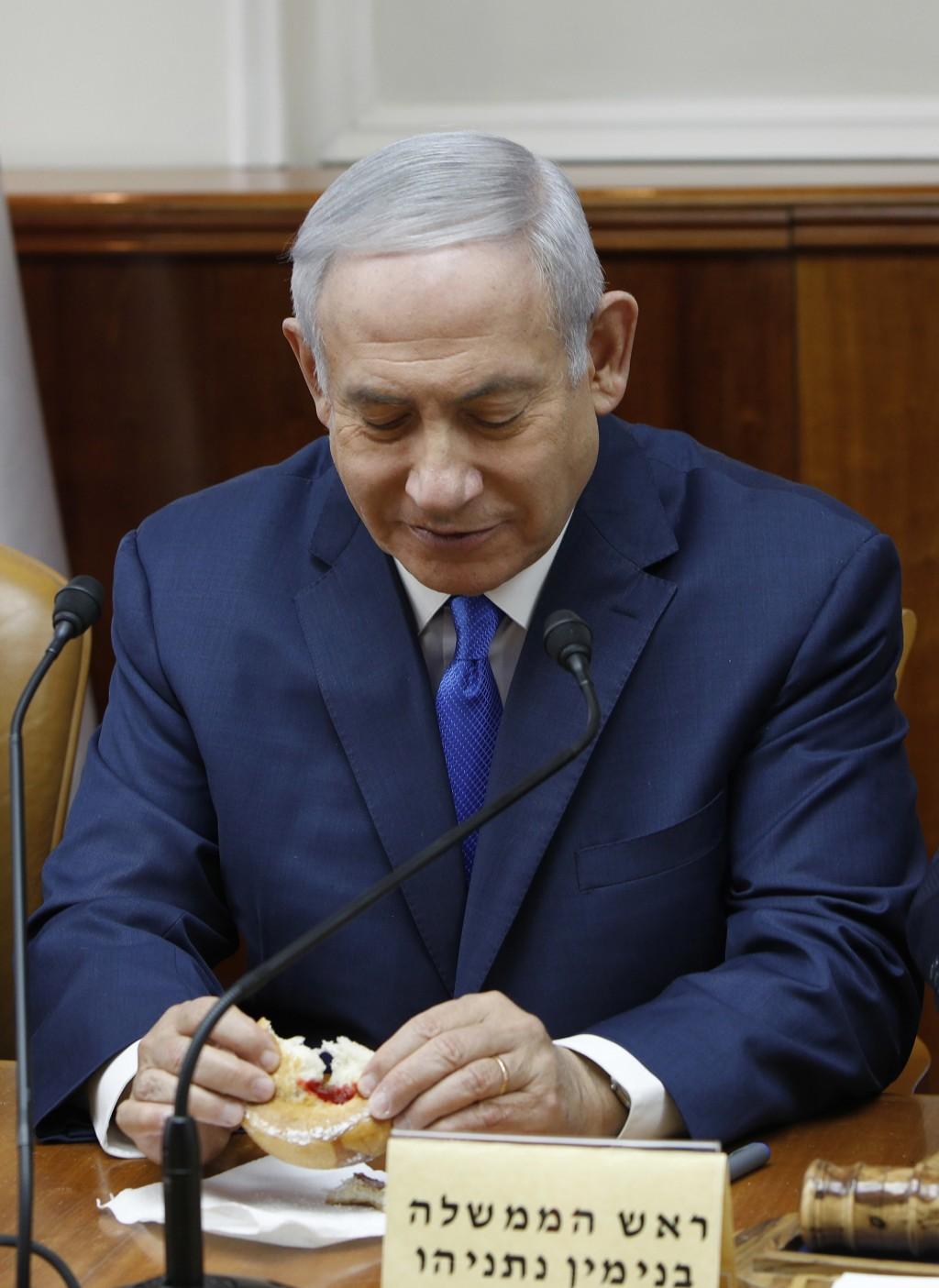 Israeli Prime Minister Benjamin Netanyahu attends the weekly cabinet meeting at his office in Jerusalem, Sunday Dec. 2, 2018.  Israeli police on Sunda