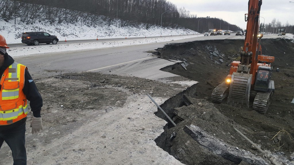 This photo provided by Chris Riekena shows excavation work being conducted Saturday, Dec. 1, 2018, near the Mirror Lake exit of the Glenn Highway near...