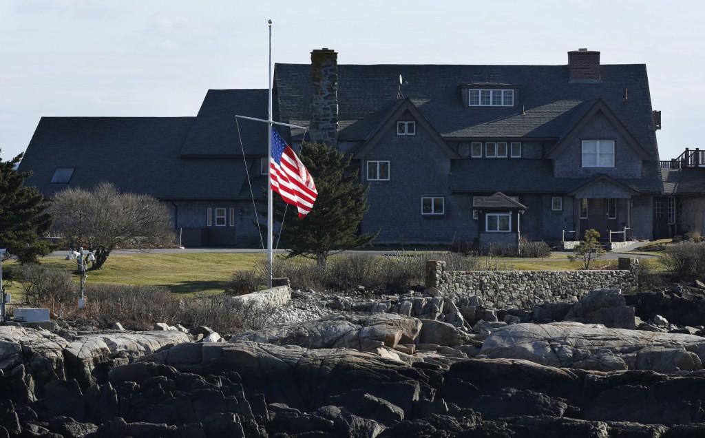 The American flag flies at half-mast at Walker's Point, the summer home of former President George H. W. Bush, Saturday, Dec. 1, 2018, in Kennebunkpor