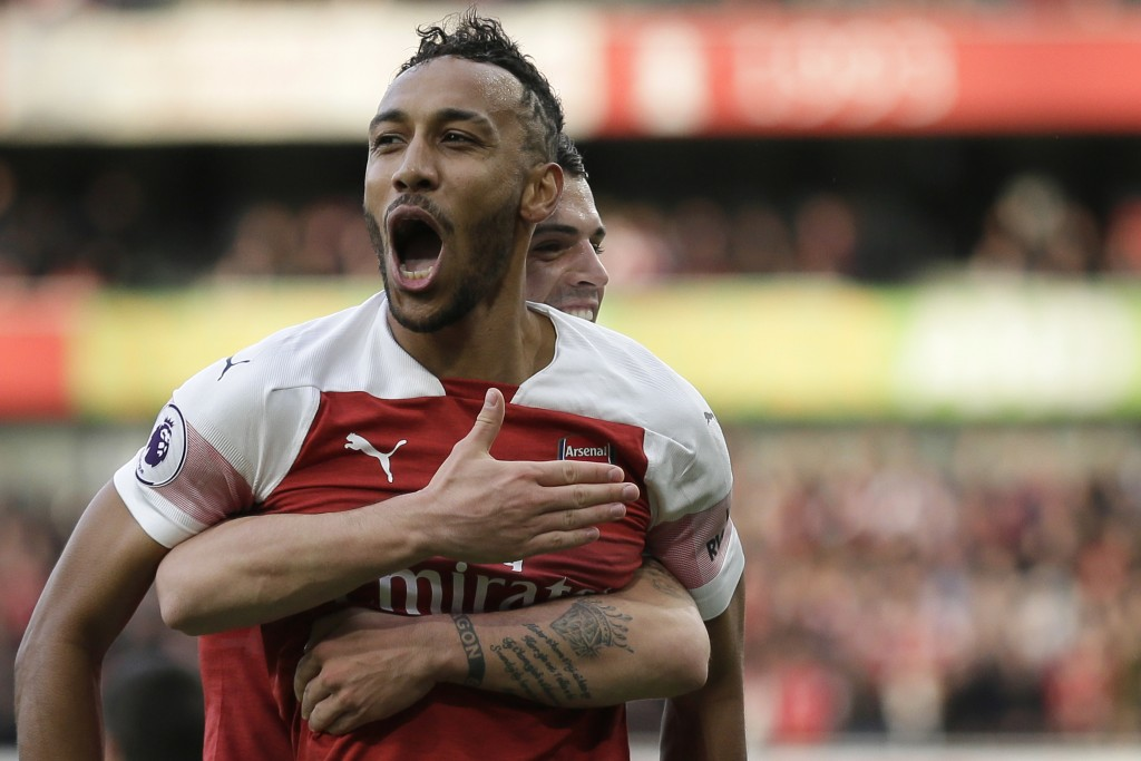 Arsenal's Pierre-Emerick Aubameyang celebrates after scoring his side's opening goal from a penalty spot during the English Premier League soccer matc