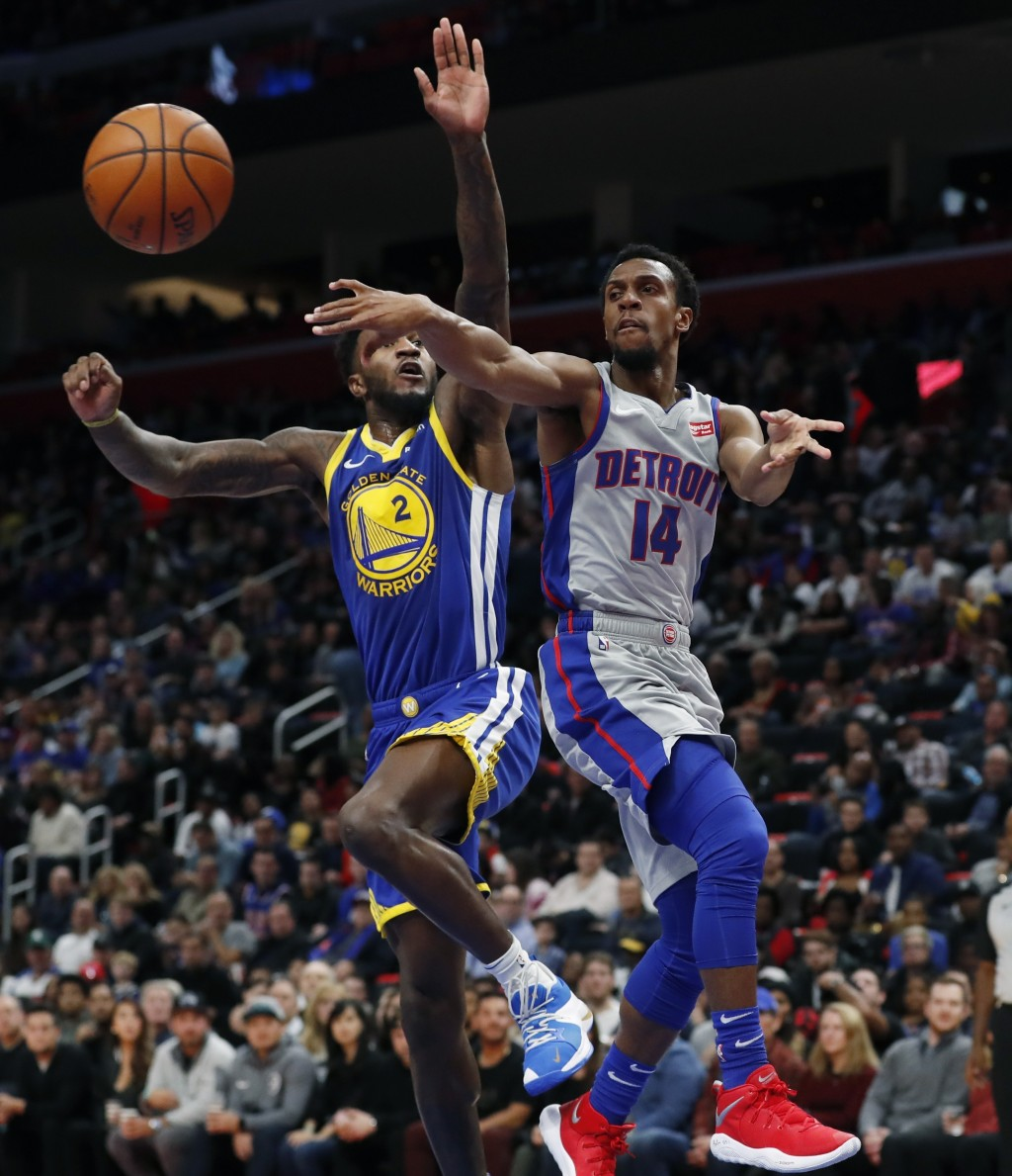 Detroit Pistons guard Ish Smith (14) passes as Golden State Warriors forward Jordan Bell (2) defends during the first half of an NBA basketball game,
