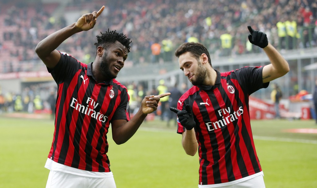AC Milan's Franck Kessie, left, celebrates with his teammate Hakan Calhanoglu after scoring his side's second goal during the Serie A soccer match bet...