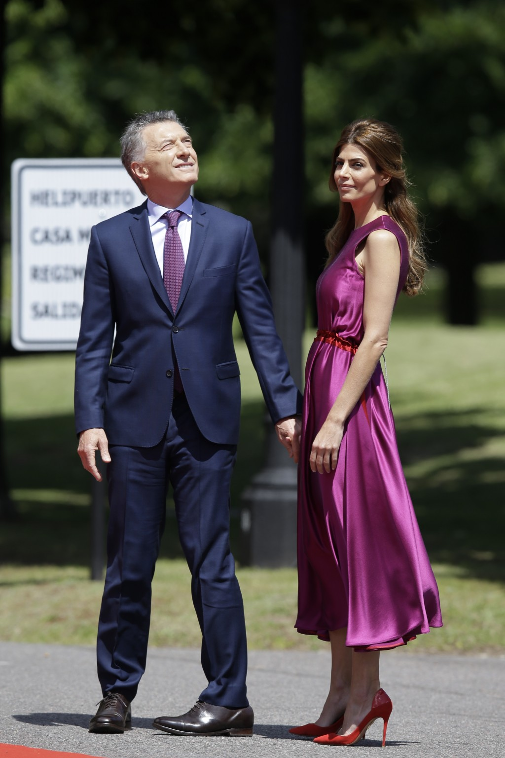 Argentina's President Mauricio Macri, left, and first lady Juliana Awada wait for the arrival of China's President Xi Jinping at presidential residenc...