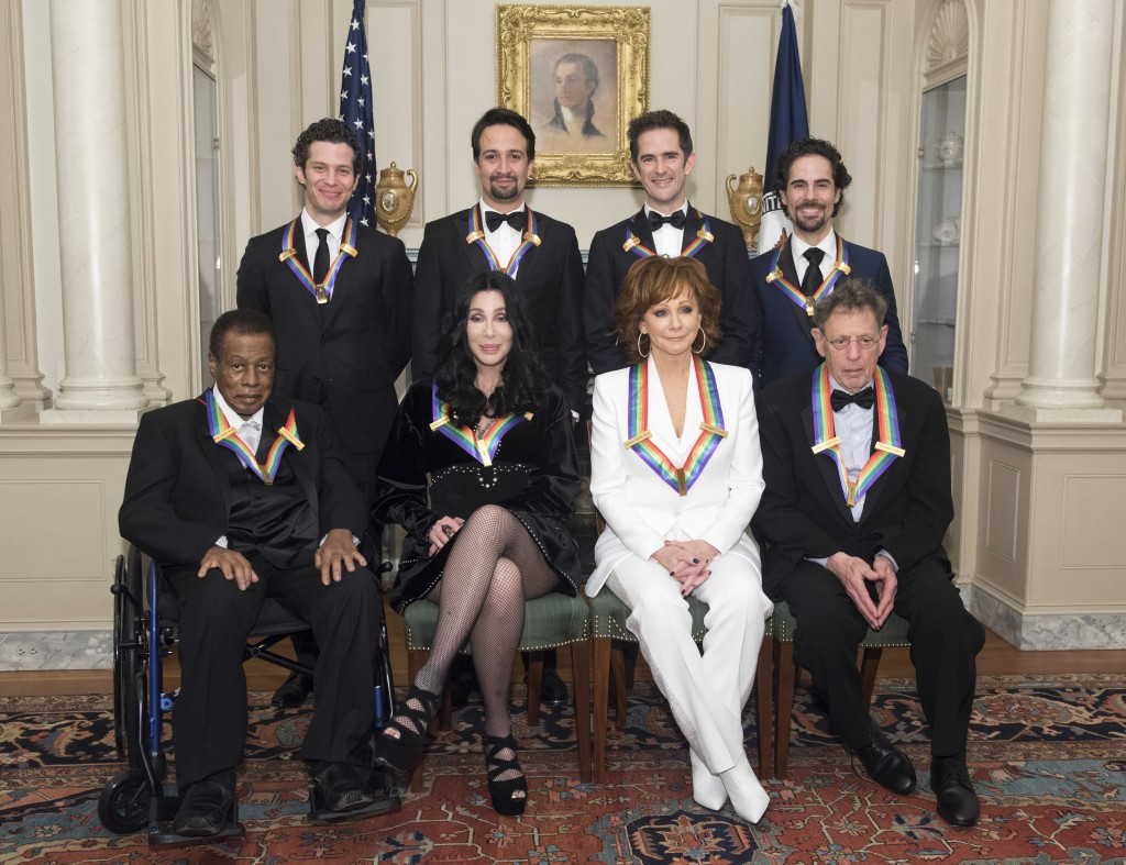 "2018 Kennedy Center Honorees, front row form left, Wayne Shorter, Cher, Reba McEntire, Philip Glass, back row from left, the co-creators of ""Hamilton,"