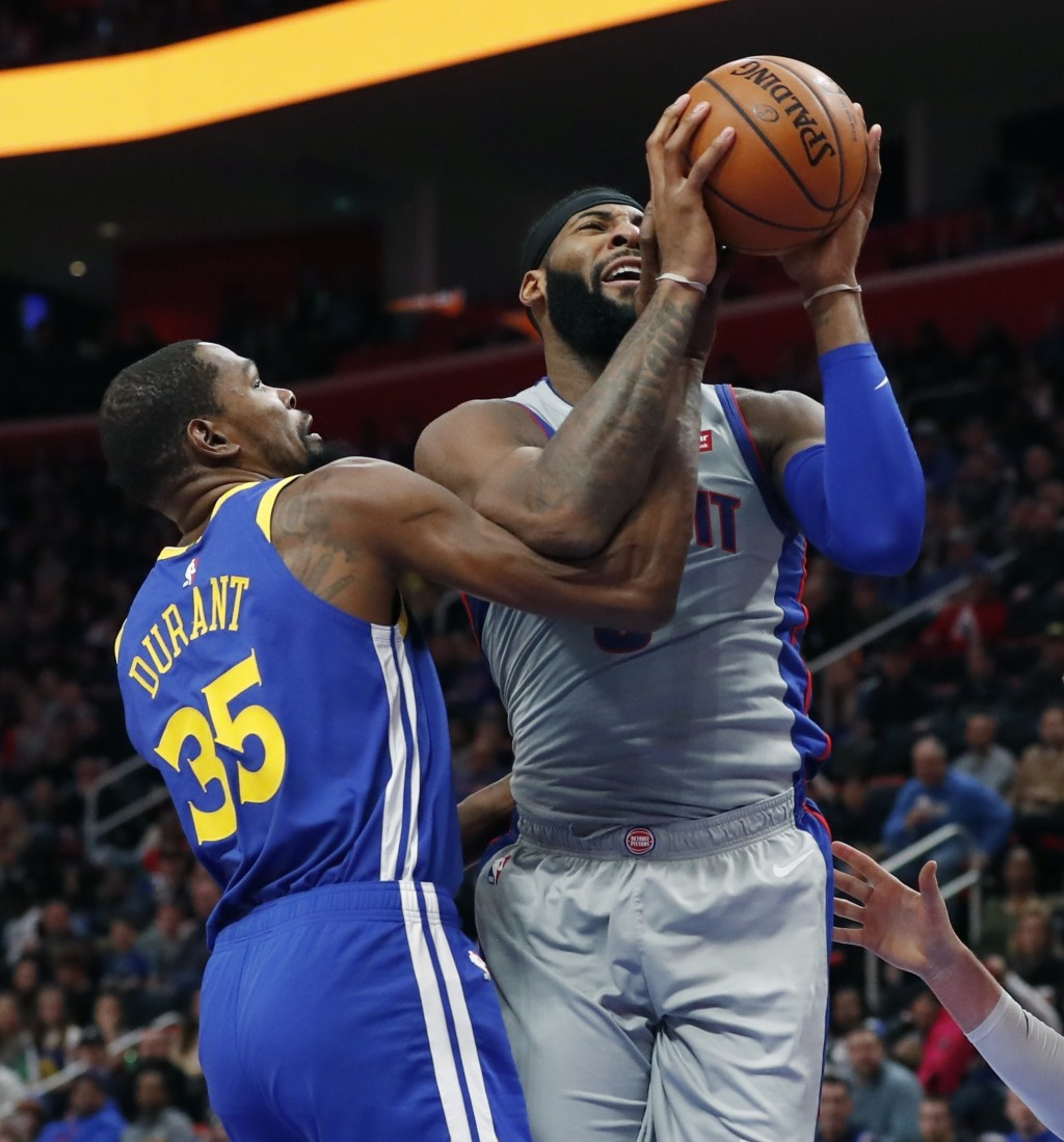 Golden State Warriors forward Kevin Durant (35) reaches in on Detroit Pistons center Andre Drummond (0) during the first half of an NBA basketball gam
