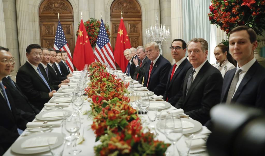 President Donald Trump with China's President Xi Jinping and members of their official delegations during their bilateral meeting at the G20 Summit, S