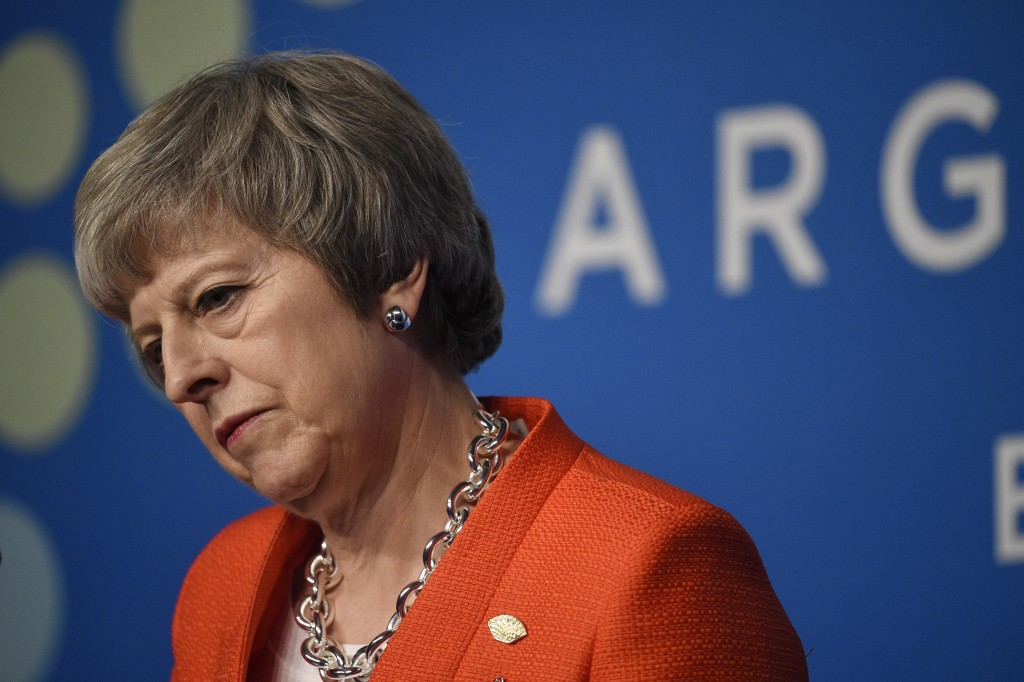 Britain's Prime Minister Theresa May listens to a question during a press conference after the G20 Leader's Summit in Buenos Aires, Argentina, Saturda...