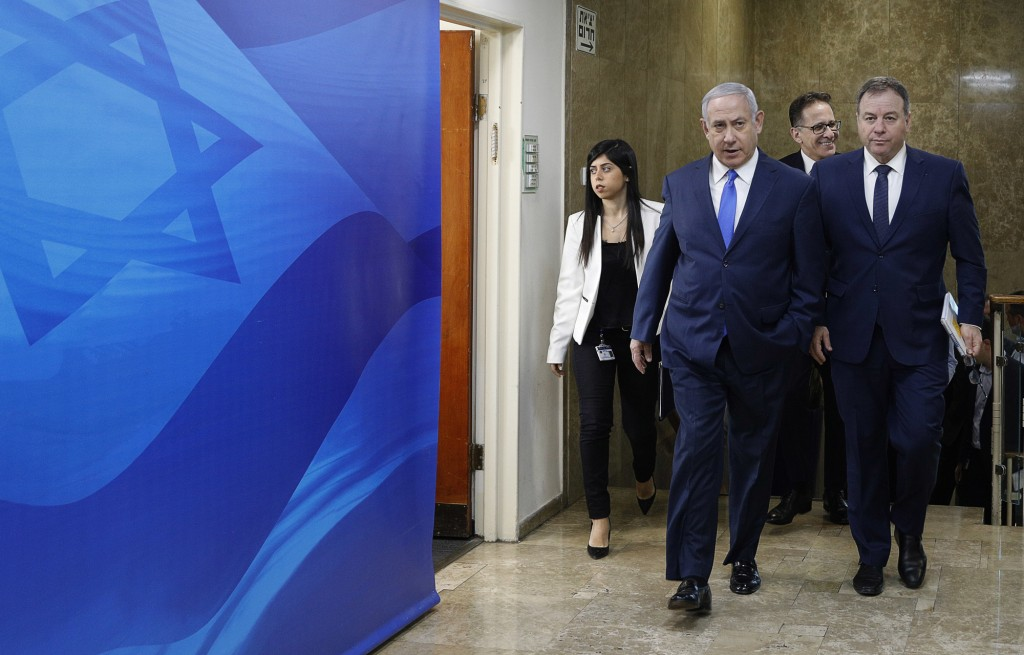 Israeli Prime Minister Benjamin Netanyahu arrives for the weekly cabinet meeting at his office in Jerusalem, Sunday Dec. 2, 2018.  Israeli police on S...