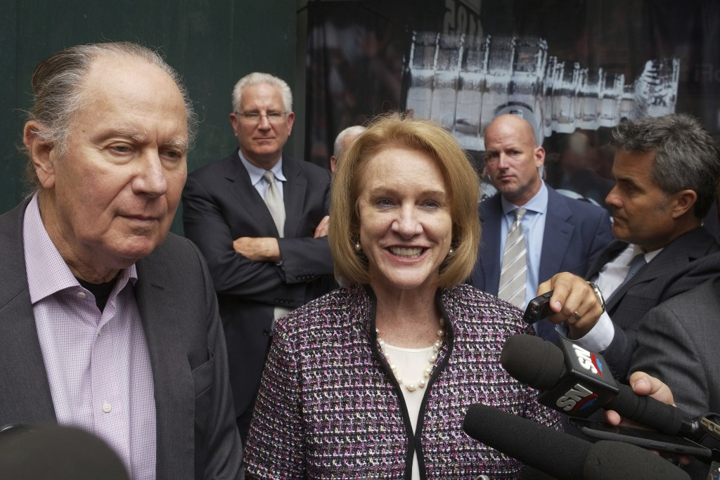 FILE - In this Oct. 2, 2018, file photo, Seattle Hockey Partners David Bonderman, left, and Seattle Mayor Jenny Durkan talk to the media as they leave...
