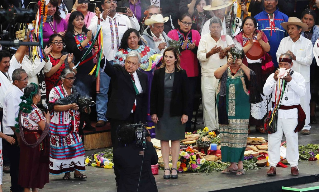 Mexico's new President Andres Manuel Lopez Obrador, center, participates in a traditional indigenous ceremony at the Zocalo, in Mexico City, Saturday,...