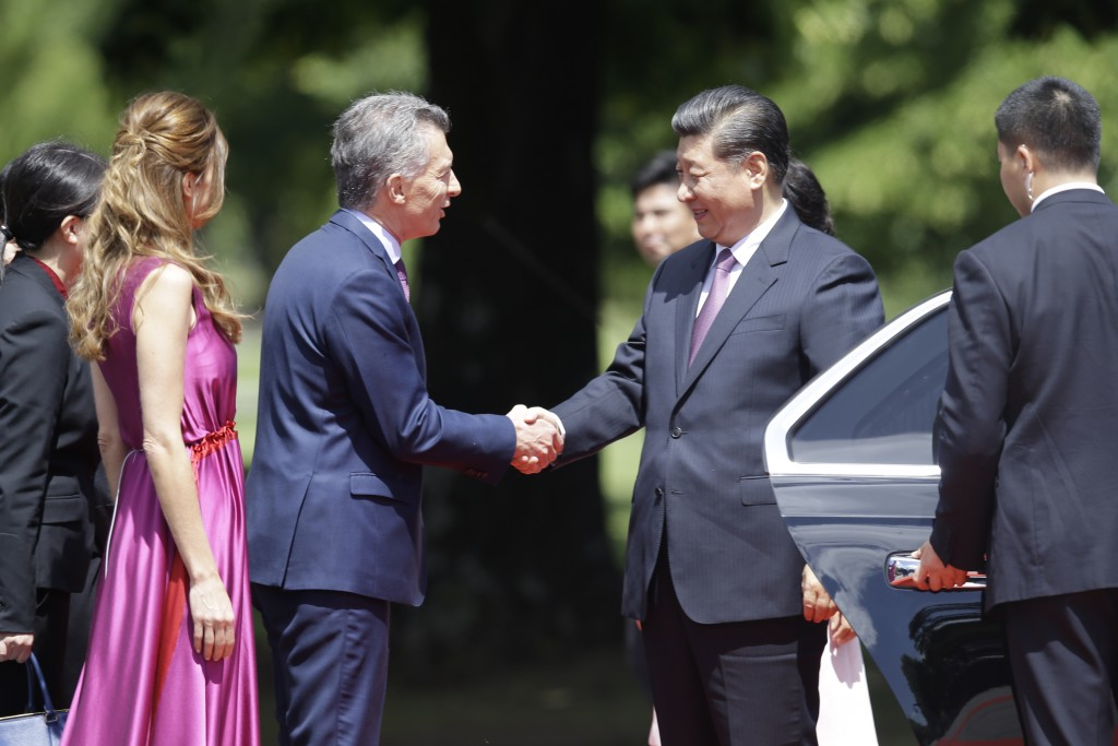 Argentina's President Mauricio Macri and first lady Juliana Awada welcome China's President Xi Jinping at presidential residence in Olivos, a northern...