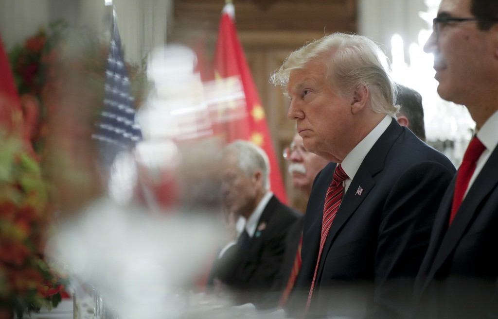 President Donald Trump listens to China's President Xi Jinping speak during their bilateral meeting at the G20 Summit, Saturday, Dec. 1, 2018 in Bueno