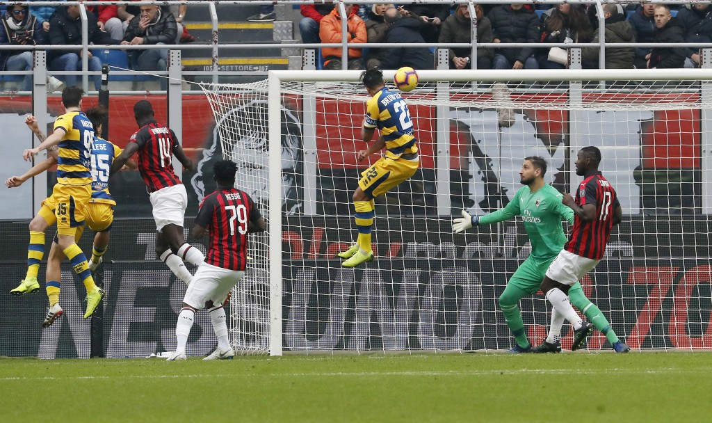 Parma's Roberto Inglese, second from left, scores his side's opening goal during the Serie A soccer match between AC Milan and Parma at the San Siro S...