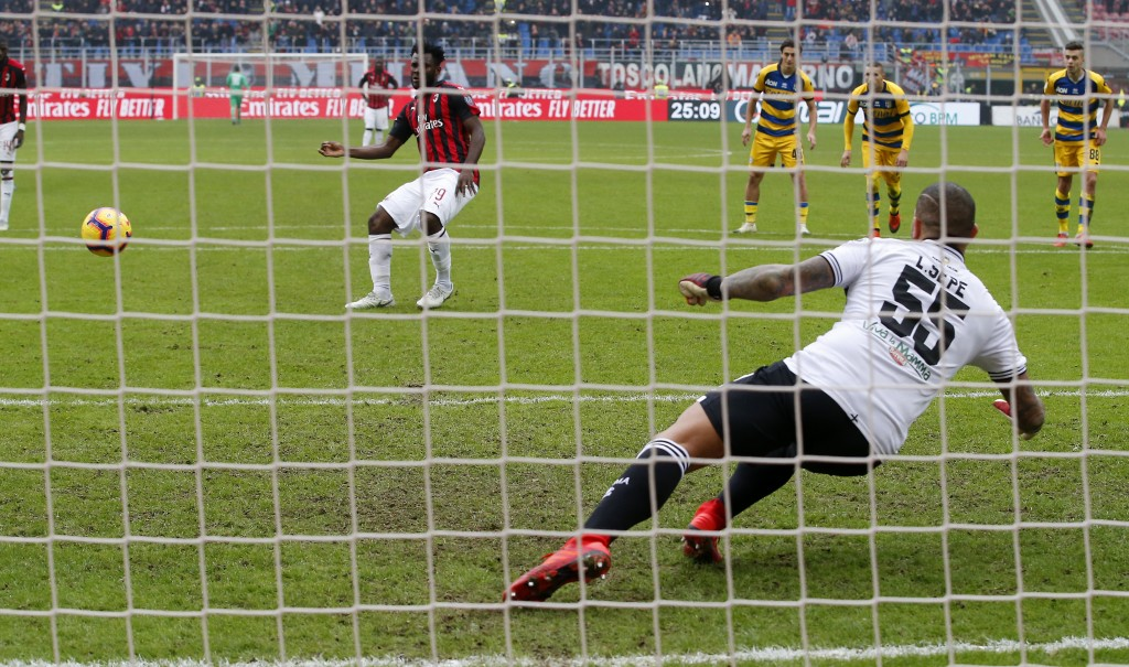 AC Milan's Franck Kessie, top left, scores on a penalty kick his side's second goal during the Serie A soccer match between AC Milan and Parma at the ...
