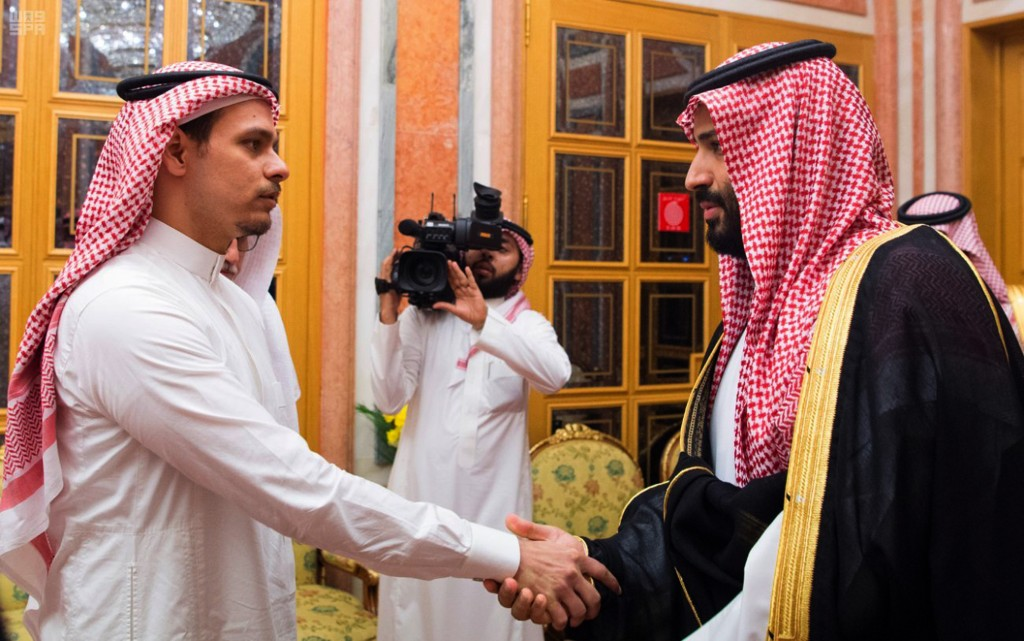 In this photo released by the Saudi Press Agency, Saudi Crown Prince Mohammed bin Salman, right, shakes hands with Salah Khashoggi, a son of Jamal Kha...