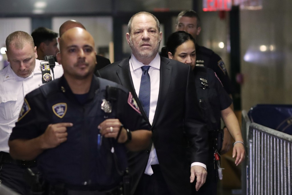 Harvey Weinstein, center, enters State Supreme Court in New York on Oct. 11, 2018. A year earlier, Weinstein was a catalyst in launching the #MeToo mo...