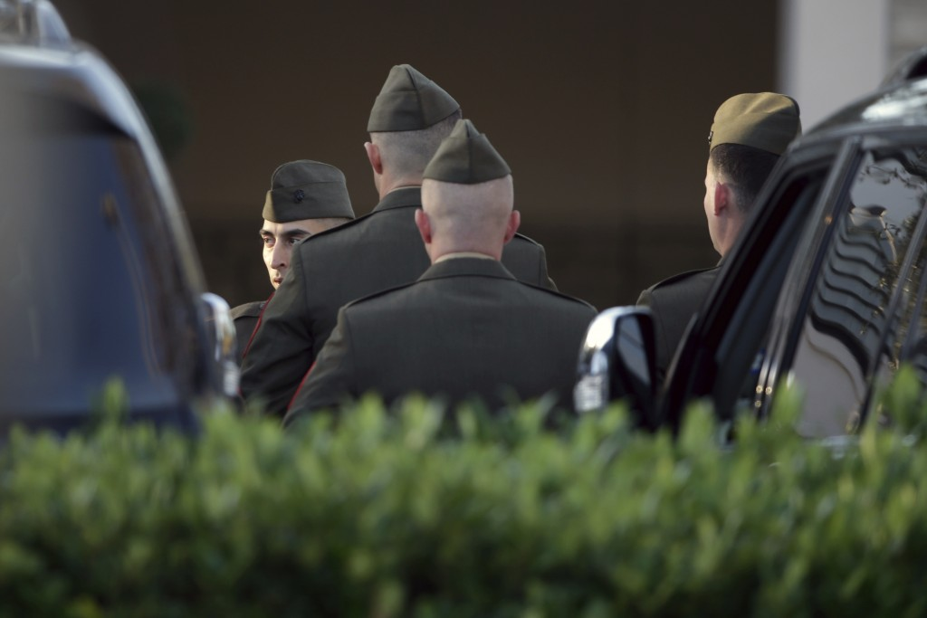 Members of a color guard gather outside the George H. Lewis Funeral Home as they prepare for a departure ceremony for the state funeral for former Pre