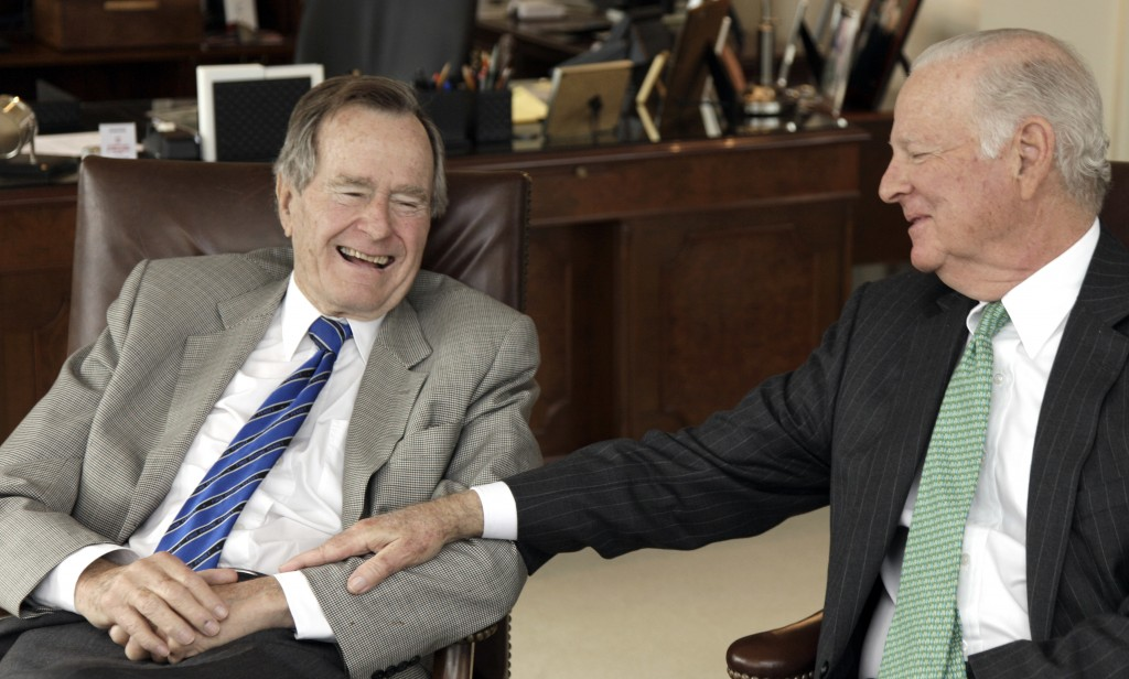 FILE - In this Jan. 18, 2011 file photo, former President George H.W. Bush, left, and former Secretary of State James A. Baker III share a moment as t...