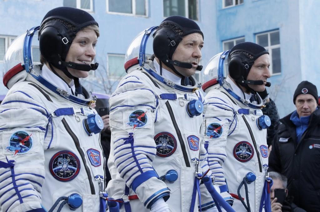 U.S. astronaut Anne McClain, left, Russian cosmonaut Оleg Kononenko, centre, and CSA astronaut David Saint Jacques, members of the main crew of the e