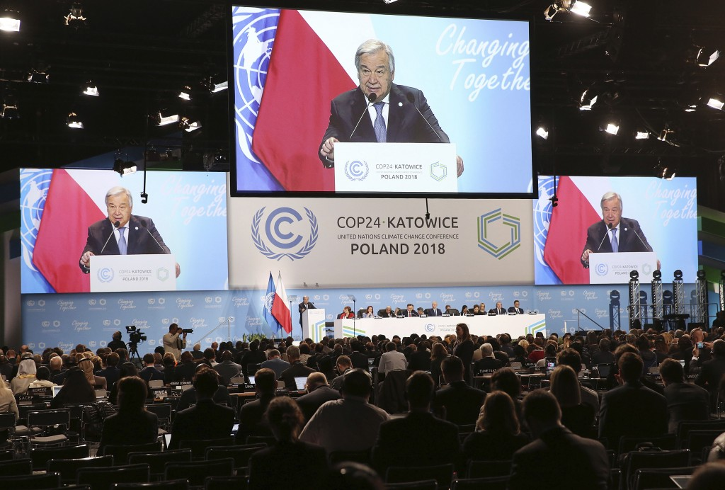 UN Secretary General Antonio Guterres appears on screens when delivering a speech during the opening of COP24 UN Climate Change Conference 2018 in Kat