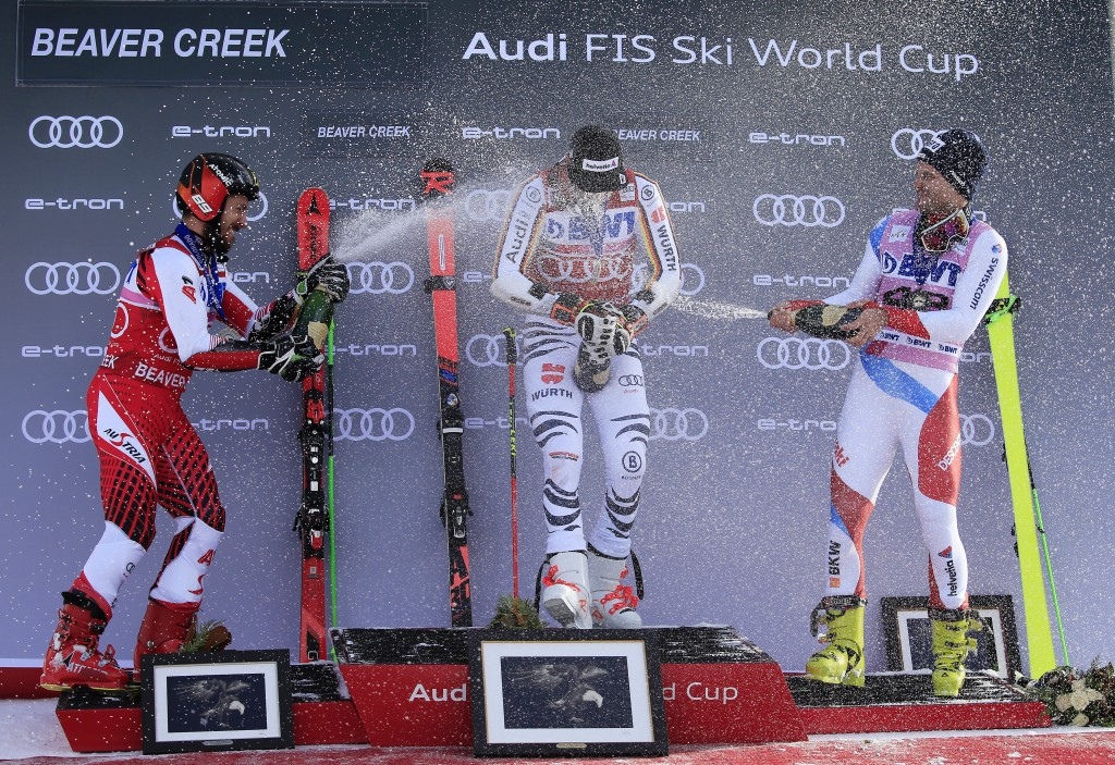From left, second place finisher Austria's Marcel Hirscher, first place finisher Germany's Stefan Luitz and third place finisher Switzerland's Thomas
