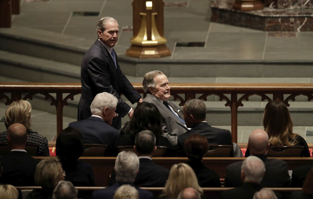 Former Presidents George W. Bush and George H.W. Bush arrive at St. Martin's Episcopal Church in Houston for the funeral for former first lady Barbara...