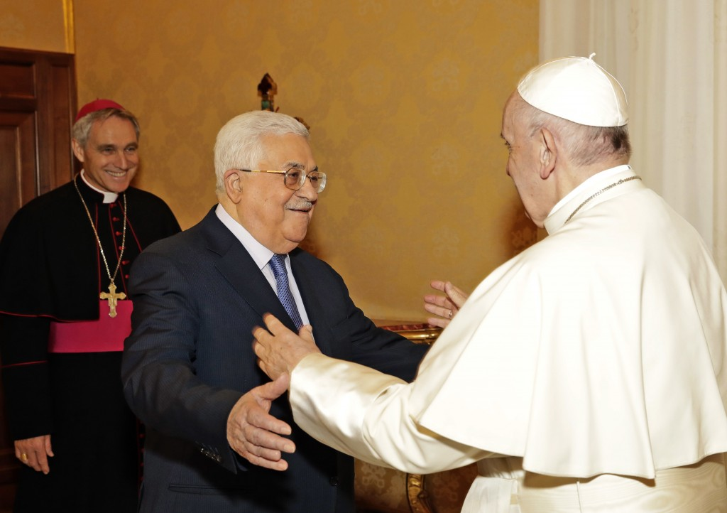 Pope Francis, right, welcomes Palestinian President Mahmoud Abbas during a private audience at the Vatican, Monday Dec. 3, 2018. (AP Photo/Andrew Medi
