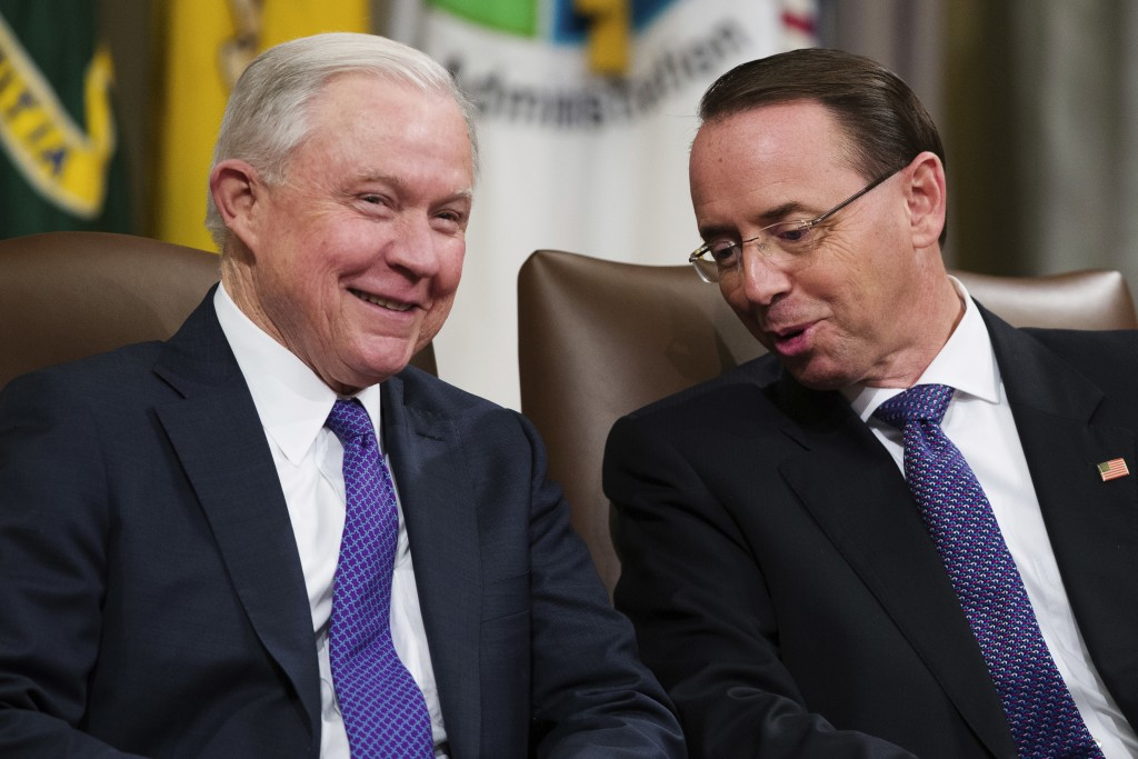 Attorney General Jeff Sessions, left, and Deputy Attorney General Rod Rosenstein, talk during an event to announce new strategic actions to combat the...