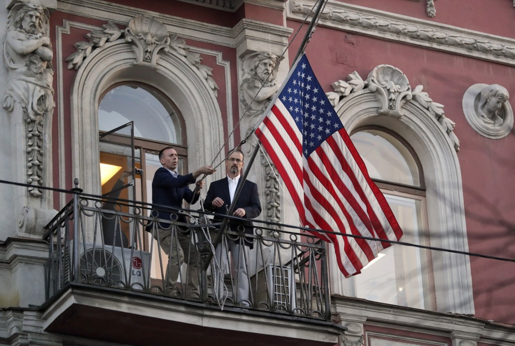 Employees at the U.S. consulate in St. Petersburg, Russia, remove the U.S flag on March 31, 2018, after Russia announced it was closing the consulate ...